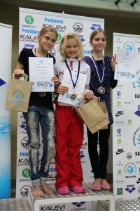 Taisia winning gold at the Tallinn Swimming Invitational.